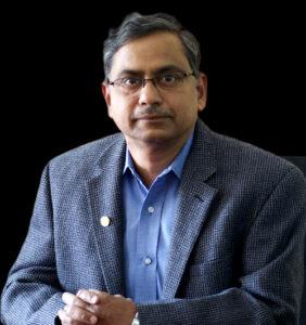 Dr Kishore Paknikar